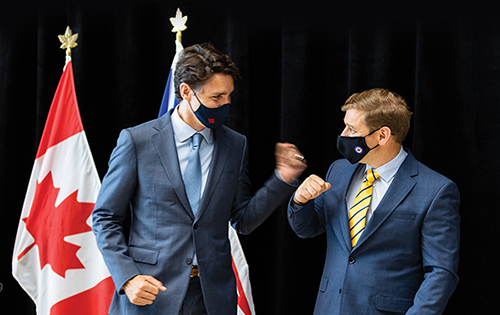Prime Minister Justin Trudeau and Premier of Newfoundland and Labrador, Andrew Furey, fist bumping