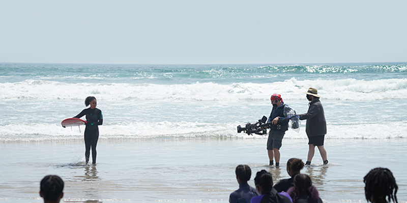 Behind the scenes on the set of Diggstown at Martinique Beach with Vinessa Antoine and members of the North Preston Surf Program (Photo credit: Dan Callis; Courtesy of CBC)